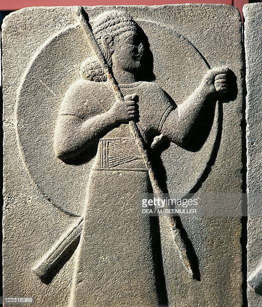 Hittite civilization 9th century bC Relief depicting warrior armed with spear and shield From Carchemish Turkey
