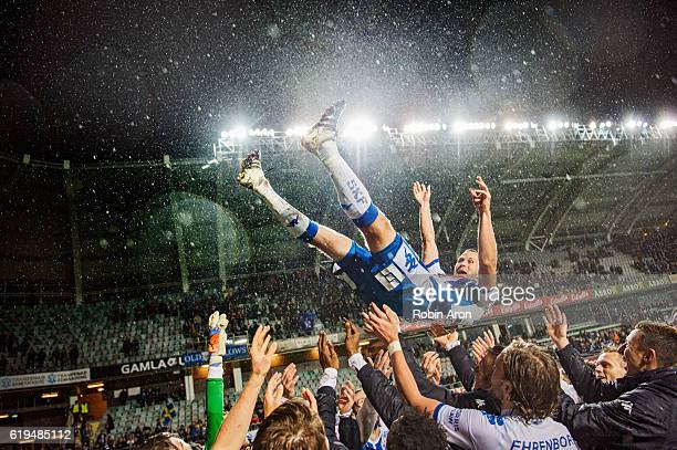 Hjalmar Jonsson of IFK Goteborg being celebrated and thrown up in the air by IFK Goteborg after playing his last home game for IFK Goteborg after the...