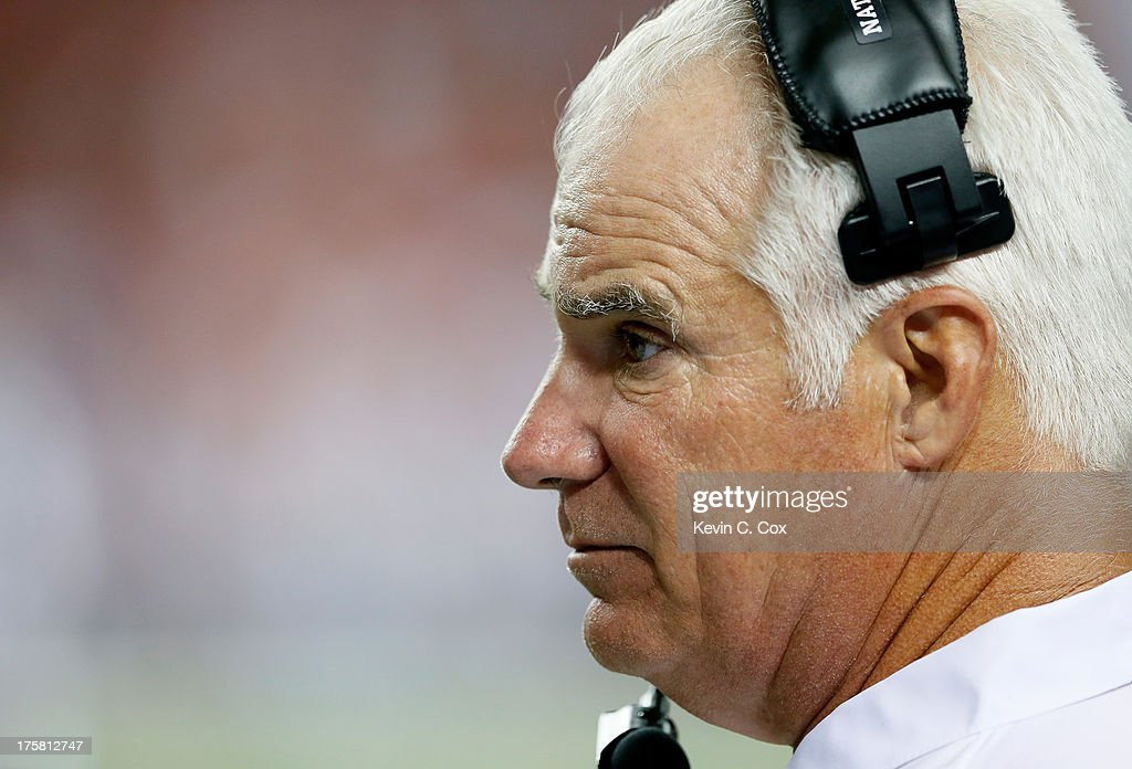 HJead coach Mike Smith of the Atlanta Falcons looks on from the sidelines against the Cincinnati Bengals at Georgia Dome on August 8, 2013 in Atlanta, Georgia.