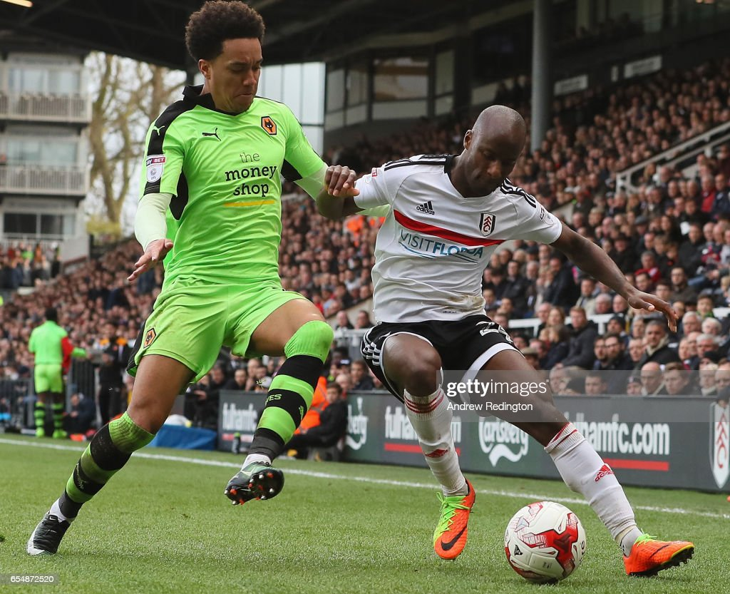 Hélder Costa of Wolverhampton Wanderers (left) and Sone Aluko of Fulham challenge for the ball during the Sky Bet Championship match between Fulham and Wolverhampton Wanderers at Craven Cottage on March 18, 2017 in London, England.