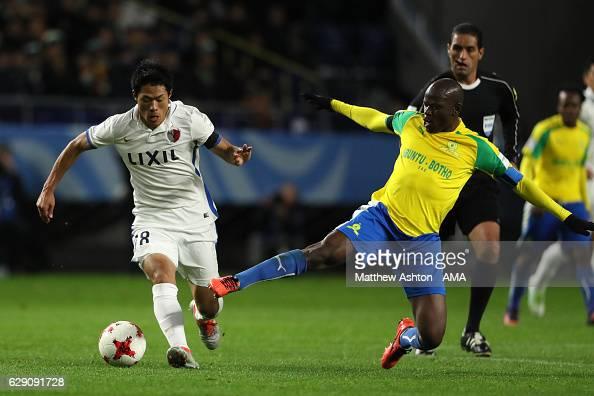 Hlompho Kekana of Mamelodi Sundowns tackles Shuhei Akasaki of Kashima Antlers during the FIFA Club World Cup Quarter Final match between Mamelodi...
