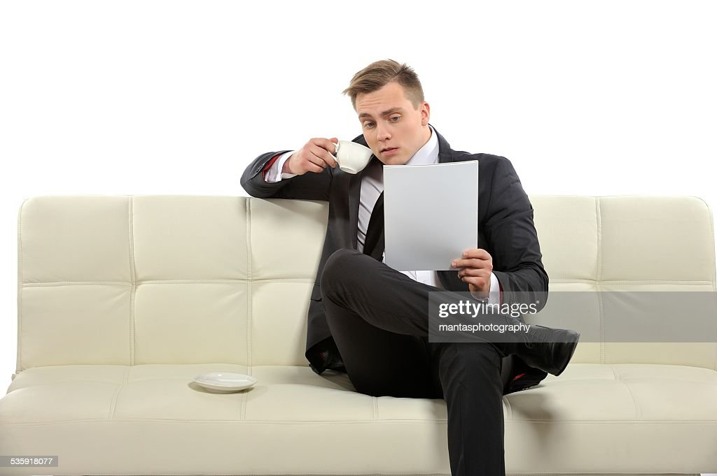 Hmm this paper is interesting.. : Stock Photo