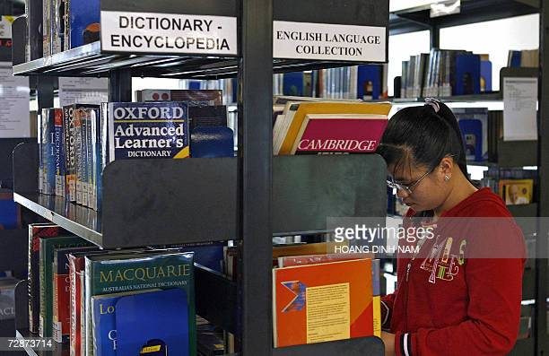 TO GO WITH AFP STORY AFPLifestyleVietnameducationschedFEATURE A student chooses books at the library of RMIT International University Vietnam in Ho...