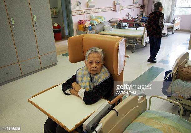 Ho Yuk an elderly woman in her late 90s looks on at an elderly care home in Hong Kong on April 18 2012 According to the World Health Organization...