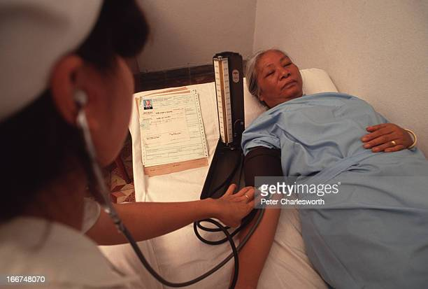 Hoang Minh has her blood pressure checked during a medical check up with her family as part of their application to leave Vietnam under the Orderly...