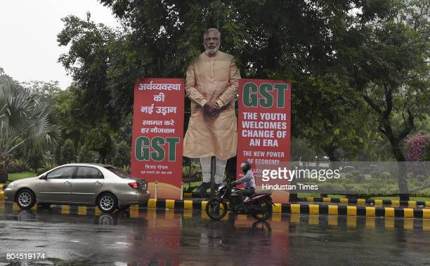 Hoarding on GST near Ashoka road on June 30 2017 in New Delhi India With a gong sound at midnight in Parliament's Central Hall India will switch to...
