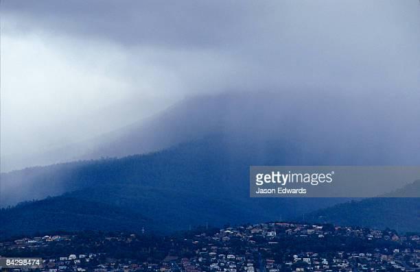 torrential storm clouds envelope Hobart and Mount Wellington