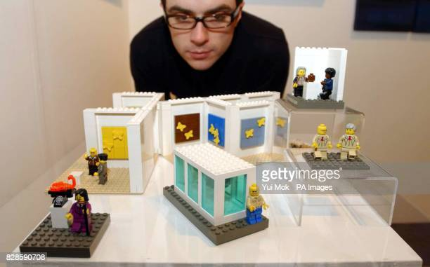 Hobby Manager of the gallery Catto Contemporary looks over a work of art by The Little Artists a miniature Lego recreation of Britart icons such as...
