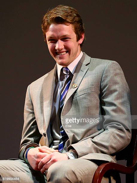 Hobey Baker Award finalist Thatcher Demko of Boston College listens as his father is interviewed on stage during the 2016 Hobey Baker Memorial Award...