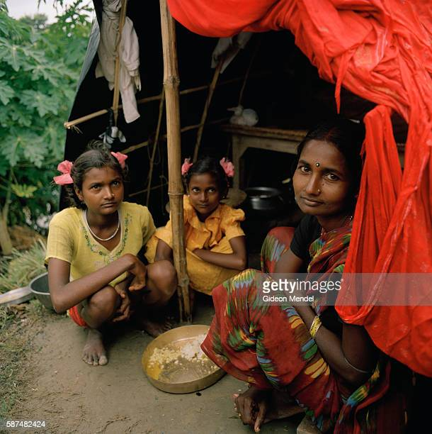 Hobha Devi with her two daughters Khusboo and Priyanka in their makeshift plastic shelter set up on a road embankment in east Champaran They had to...