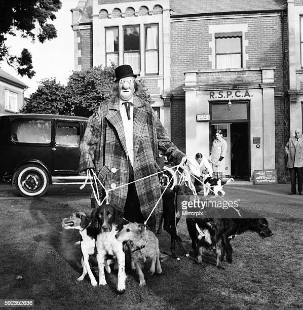 'Hobo' plays host to the doggy guests enjoying a menu of biscuits dogmeat turkey gravysauce and chocolatedrops December 1970 7011583012