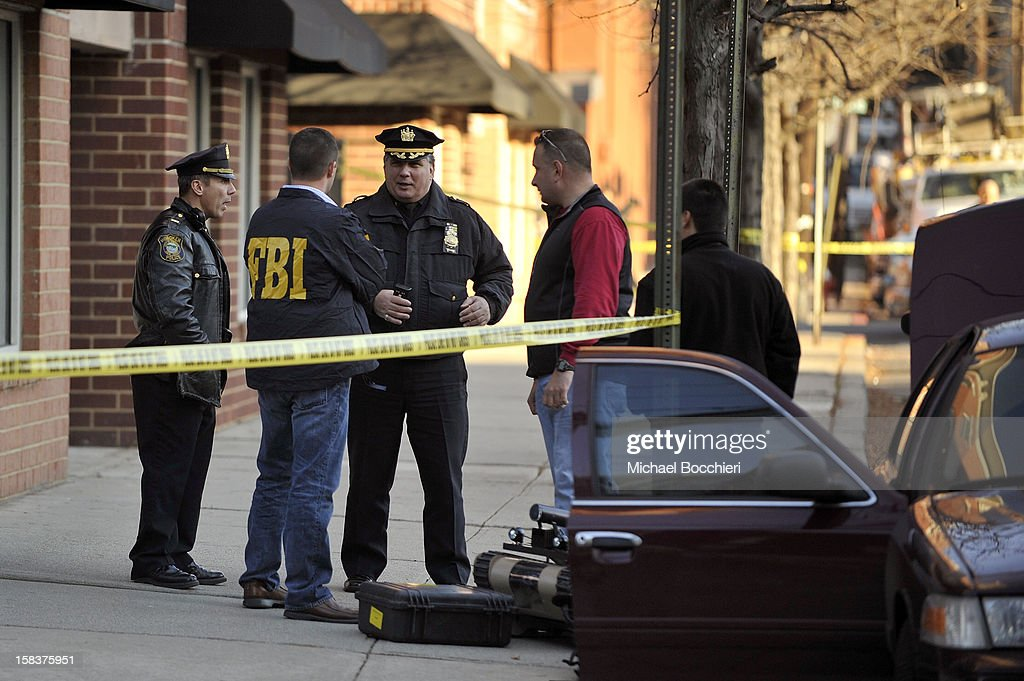 Hoboken Police Department Captain James Fitzsimmons speaks with other law enforcement including FBI at a scene at 1313 Grand St which is believed to...