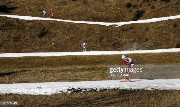 Competitors comete in the women's 75 km sprint during the IBU Biathlon World Cup in Hochfilzen 08 December 2006 Germany's Henkel won ahead of...