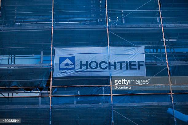 A Hochtief AG logo sits on scaffolding outside a development of new residential apartments part of the Lux project operated by Ziegert Immobilien...
