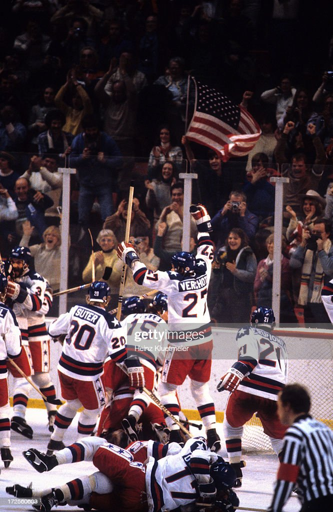 1980 Winter Olympics Overall view of Team USA Bob Suter Mark Wells and Phil Verchota victorious on ice after winning Medal Round game vs USSR at...
