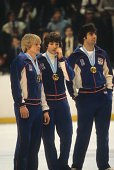 1980 Winter Olympics Team USA Bob Suter Mark Johnson and Jim Craig victorious with gold medals after winning Gold Medal Game vs Finland at Olympic...