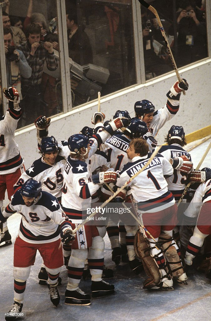Team USA goalie Steve Janaszak (1), Steve Christoff (11), Mark Wells (15), Bill Baker (6), and teammates victorious after winning Medal Round game vs USSR at Olympic Fieldhouse in the Olympic Center. Miracle on Ice. Neil Leifer TC22712 TK16 R1 )