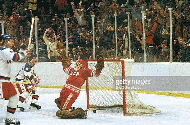 Hockey 1980 Winter Olympics USA John Harrington victorious after game winning goal vs USR goalie Vladislav Tretiak Lake Placid NY 2/22/1980