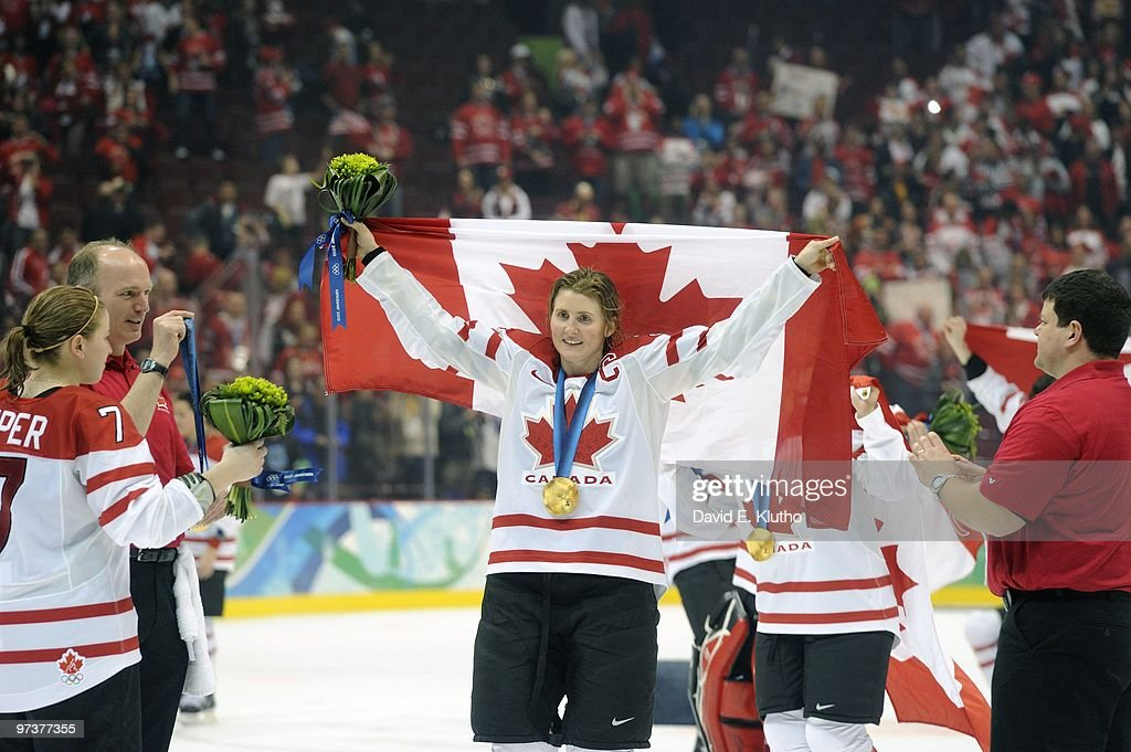 Canada Hayley Wickenheiser (22) victorious with flag after winning Women's Gold Medal Game - Game 20 vs USA at Canada Hockey Place. Vancouver, Canada 2/25/2010