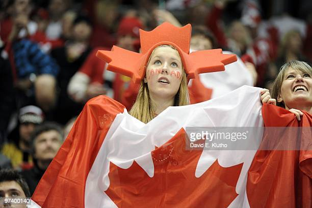 2010 Winter Olympics Team Canada fans in stands with flag during Men's Playoffs Qualifications Game 20 vs Germany at Canada Hockey Place Vancouver...