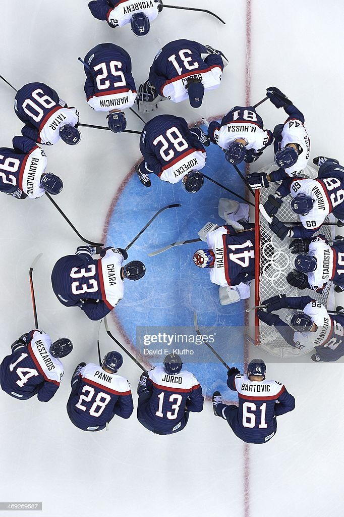 Aerial view of Slovakia Zdeno Chara (33), Tomas Kopecky (82) and goalie Jaroslav Halak (41) in huddle before game vs USA during Men's Preliminary Round - Group A game at Shayba Arena. David E. Klutho F17 )