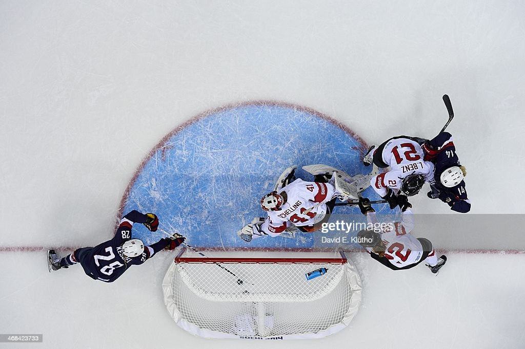 Aerial view of USA Amanda Kessel (28) in action, scoring goal vs Switzerland goalie Florence Schelling (41) during Women's Preliminary Round - Group A game at Shayba Arena. David E. Klutho X157621 TK1 R1 F9 )