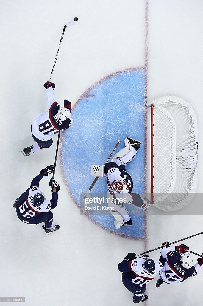 Aerial view of USA Phil Kessel (81) in action vs Slovakia goalie Jaroslav Halak (41) and Martin Marincin (52) during Men's Preliminary Round - Group A game at Shayba Arena. David E. Klutho F29 )