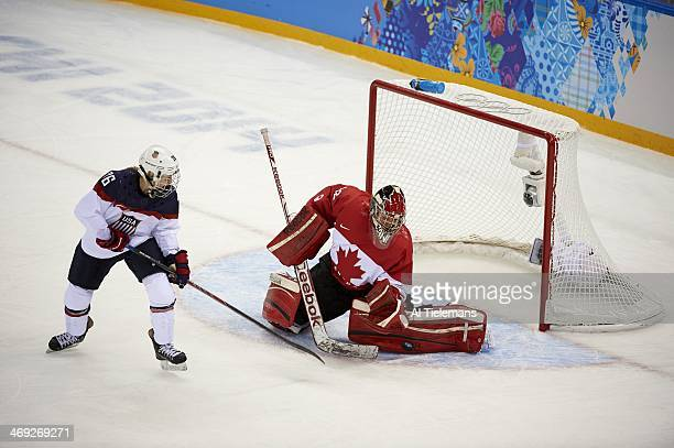 2014 Winter Olympics Canada goalie Charline Labonte in action save vs USA Kendall Coyne during Women's Preliminary Round Group A game at Shayba Arena...