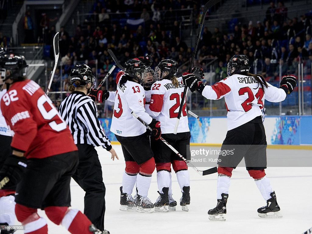 Canada Natalie Spooner (24) victorious with teammates (L-R) Caroline Ouellette (13), Catherine Ward (18), and Hayley Wickenheiser (22) after scoring her second goal vs Switzerland at 11:10 of 1st period during Women's Playoffs Semifinals at Shayba Arena. David E. Klutho X157663 TK2 R3 F96 )