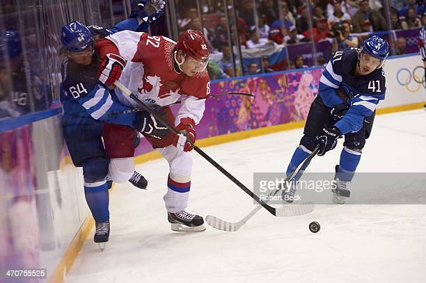 2014 Winter Olympics Finland Mikael Granlund and Antti Pihlstrom in action vs Russia Yevgeni Medvedev during Men's Playoffs Quarterfinals at Bolshoy...
