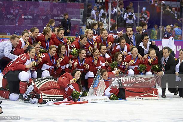 2014 Winter Olympics Portrait of Team Canada victorious posing with medals after winning Women's Gold Medal game vs USA at Bolshoy Ice Dome Sochi...