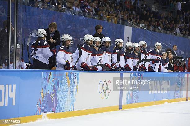2014 Winter Olympics USA Anne Schleper Michelle Picard and Lee Stecklein on bench during game vs Canada during Women's Preliminary Round Group A at...