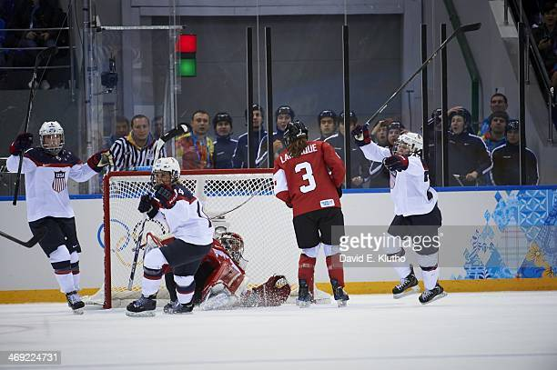 2014 Winter Olympics USA Anne Schleper victorious after scoring goal vs Canada during Women's Preliminary Round Group A at Shayba Arena Sochi Russia...