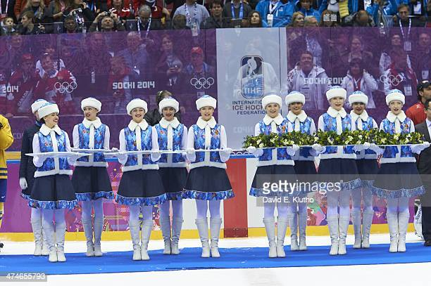 2014 Winter Olympics View of volunteers presenting flowers and medals to Team Canada after Men's Gold Medal Game vs Sweden at Bolshoy Ice Dome Sochi...