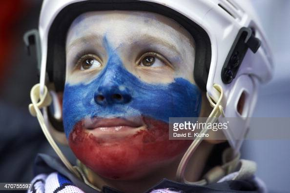 2014 Winter Olympics View of youth fan with painted face before Men's Playoffs Quarterfinals between Canada and Latvia at Bolshoy Ice Dome Sochi...