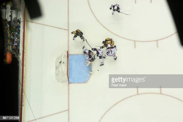 Aerial view of Edmonton Oilers goalie Cam Talbot Adam Larsson and Oscar Klefbom in action vs Pittsburgh Penguins Jake Guentzel at PPG Paints Arena...