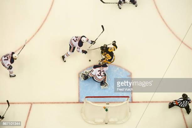 Aerial view of Edmonton Oilers goalie Cam Talbot and Oscar Klefbom in action vs Pittsburgh Penguins Jake Guentzel at PPG Paints Arena Pittsburgh PA...