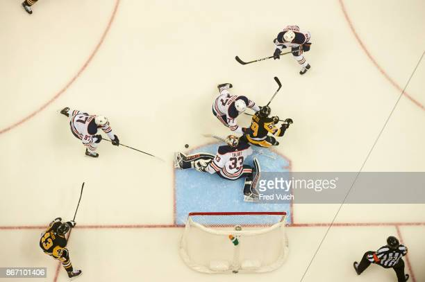 Aerial view of Edmonton Oilers goalie Cam Talbot Connor McDavid and Oscar Klefbom in action vs Pittsburgh Penguins Jake Guentzel at PPG Paints Arena...