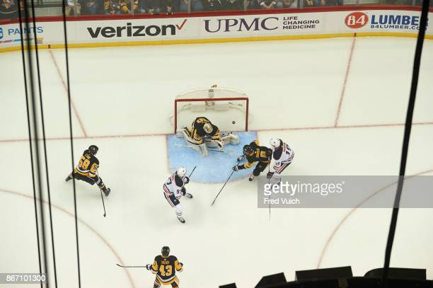 Aerial view of Pittsburgh Penguins goalie Matthew Murray and Brian Dumoulin in action yielding goal vs Edmonton Oilers Connor McDavid and Patrick...