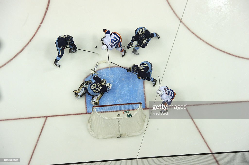 Aerial view of Pittsburgh Penguins goalie Tomas Vokoun (92), Mark Eaton (4), Brandon Sutter (16) and Matt Niskanen (2) in action vs New York Islanders Josh Bailey (12) at Consol Energy Center. Fred Vuich F20 )
