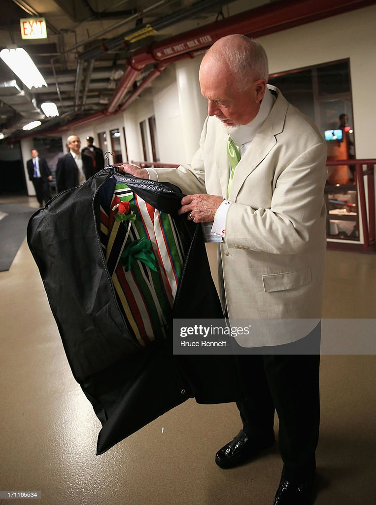 Hockey analyst Don Cherry inspects the suit he plans to wear for Game Five of the 2013 NHL Stanley Cup Final between the Chicago Blackhawks and the Boston Bruins at United Center on June 22, 2013 in Chicago, Illinois.