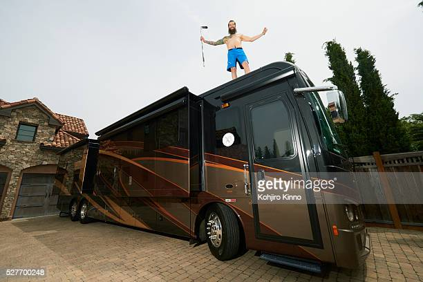 Casual portrait of San Jose Sharks defenseman Brent Burns posing shirtless on top of his 441/2 foot RV during photo shoot outside his home San Jose...