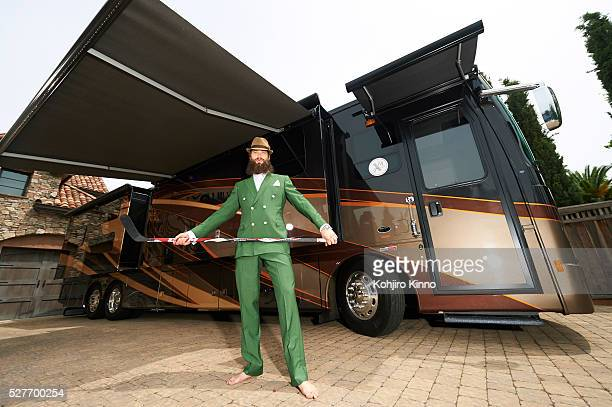 Casual portrait of San Jose Sharks defenseman Brent Burns posing with hockey stick in front of his 441/2 foot RV during photo shoot outside his home...