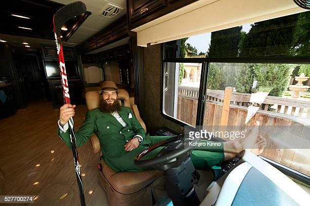 Casual portrait of San Jose Sharks defenseman Brent Burns posing with hockey stick during photo shoot in his 441/2 foot RV San Jose CA CREDIT Kohjiro...
