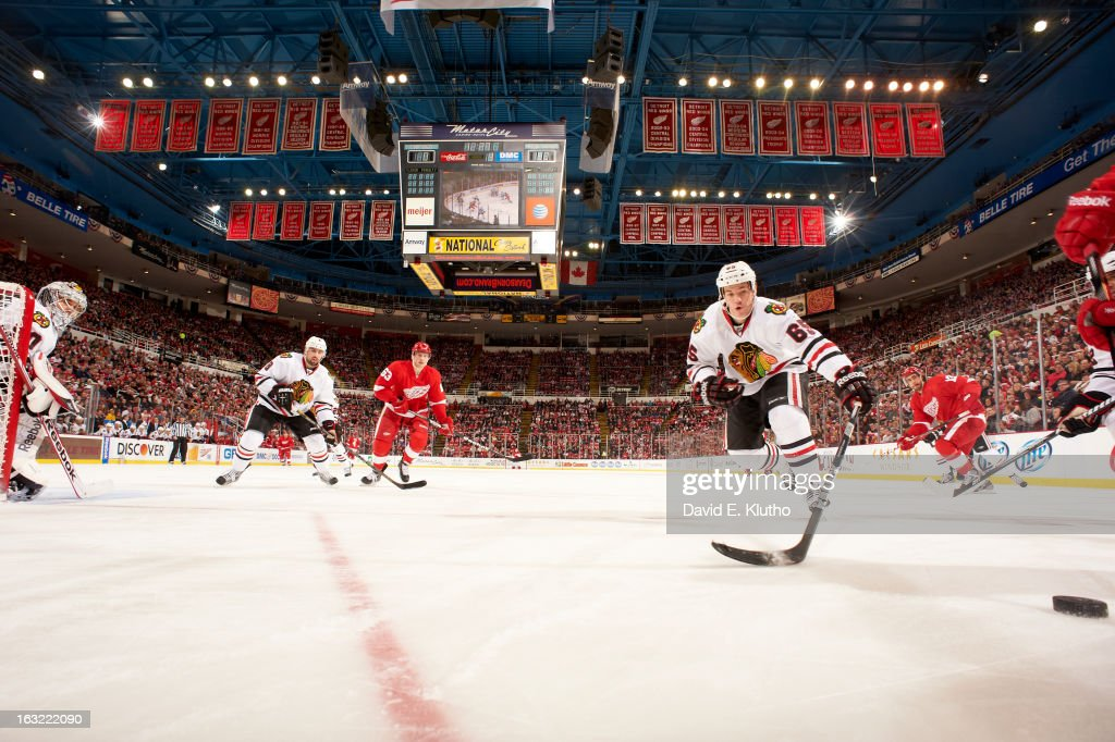 Chicago Blackhawks goalie Corey Crawford (50), Andrew Shaw (65) and Nick Leddy (8) in action vs Detroit Red Wings Joakim Andersson (63) at Joe Louis Arena. David E. Klutho F15 )