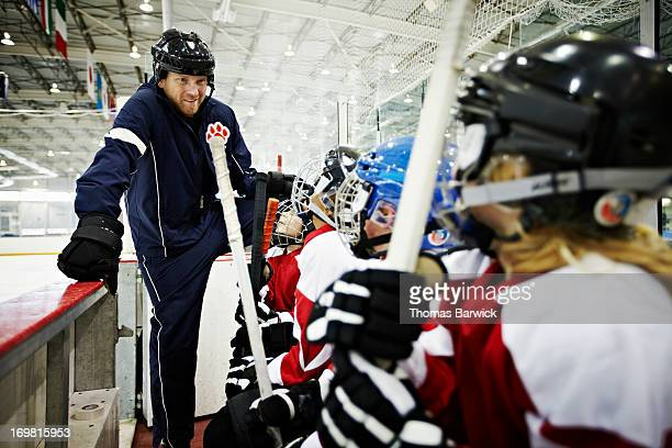 Hockey coach encouraging team of young players
