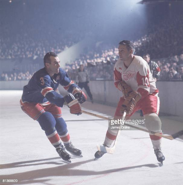 Hockey Detroit Red Wings Alex Delvecchio in action vs New York Rangers Harry Howell 1/1/19673/31/1967