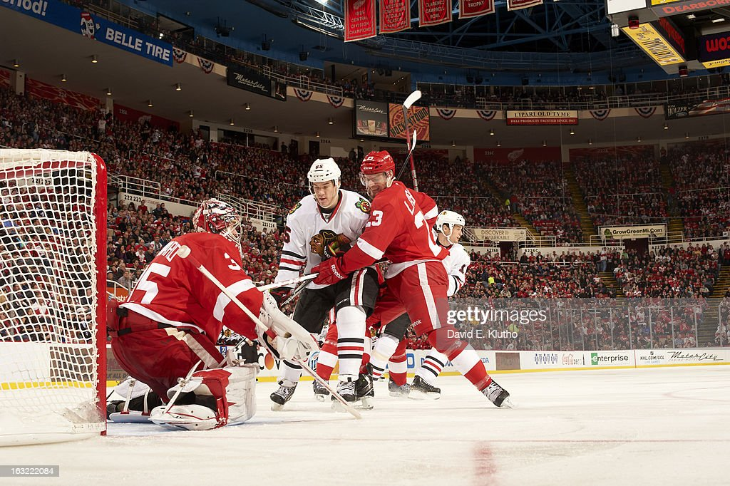 Detroit Red Wings goalie Jimmy Howard (35) and Brian Lashoff (23) in action vs Chicago Blackhawks Andrew Shaw (65) at Joe Louis Arena. David E. Klutho F39 )