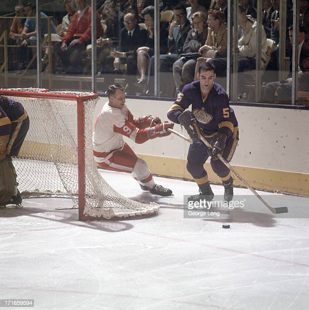 Detroit Red Wings Gordie Howe in action forecheck vs Los Angeles Kings Brent Hughes at The Forum Inglewood CA CREDIT George Long