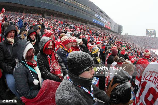 Hockey fans are seen watching the game from the upper seats during the 2014 Bridgestone NHL Winter Classic on January 1 2014 at Michigan Stadium in...